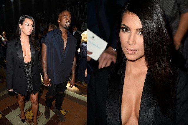 Kim Kardashian, giacca aperta e seno a vista